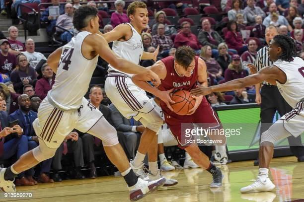 South Carolina Gamecocks forward Maik Kotsar is fouled as he splits two defenders on the way to the basket during the basketball game between the...