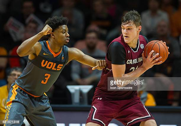 South Carolina Gamecocks forward Maik Kotsar is guarded by Tennessee Volunteers guard Robert Hubbs III during a game between the South Carolina...