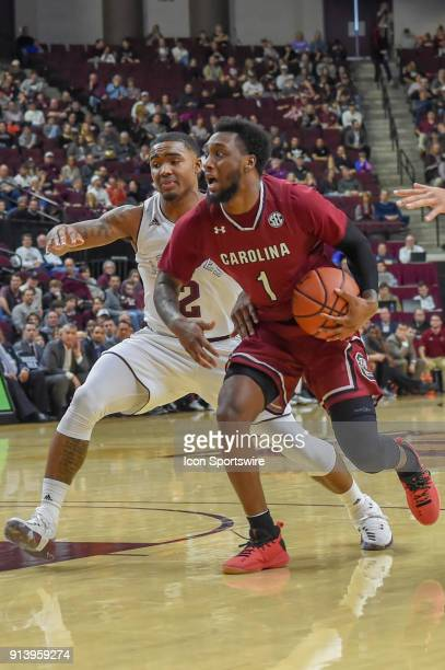 South Carolina Gamecocks guard Kory Holden drives around Texas AM Aggie guard TJ Starks during the basketball game between the South Carolina...