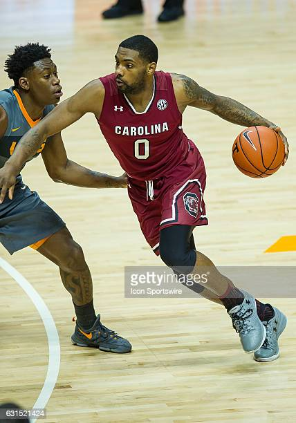 South Carolina Gamecocks guard Sindarius Thornwell drives around Tennessee Volunteers forward Admiral Schofield during a game between the South...