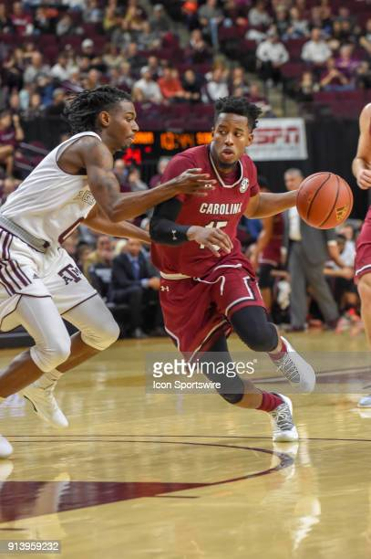 South Carolina Gamecocks guard Wesley Myers drives on Texas AM Aggie guard Jay Jay Chandler during the basketball game between the South Carolina...