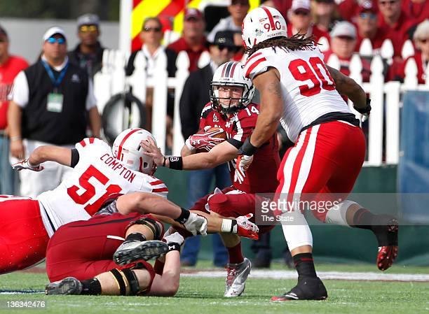 South Carolina Gamecocks quarterback Connor Shaw looks for room to run as Nebraska linebacker Will Compton pursues during the third quarter of the...