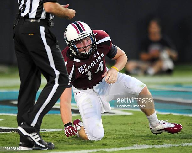 South Carolina Gamecocks quarterback Connor Shaw looks toward the sideline after being hit by the East Carolina defense during firstquarter action at...