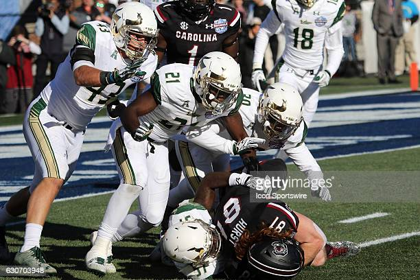 South Carolina Gamecocks tight end Hayden Hurst is brought down by by South Florida Bulls linebacker Auggie Sanchez South Florida Bulls safety Khalid...