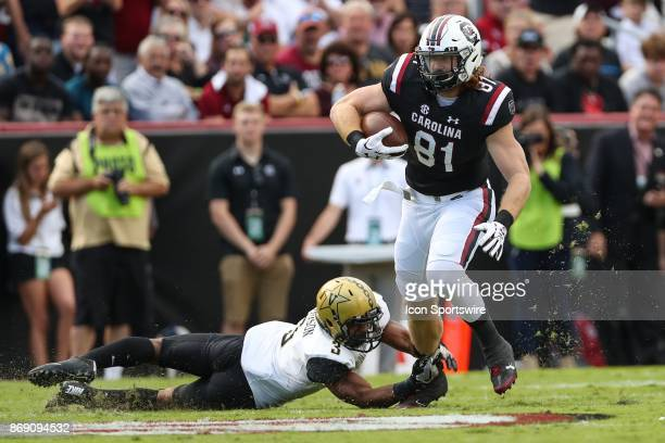 South Carolina Gamecocks tight end Hayden Hurst runs past Vanderbilt Commodores cornerback Taurean Ferguson during SEC play on October 28 2017...