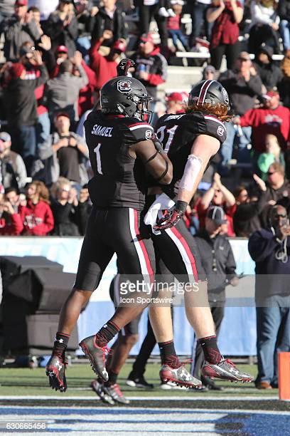 South Carolina Gamecocks wide receiver Deebo Samuel and South Carolina Gamecocks tight end Hayden Hurst celebrate a touchdown in the Birmingham Bowl...