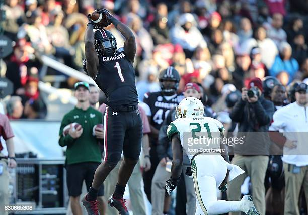 South Carolina Gamecocks wide receiver Deebo Samuel leaps in the air for a pass during the 2016 Birmingham Bowl between the South Carolina Gamecocks...