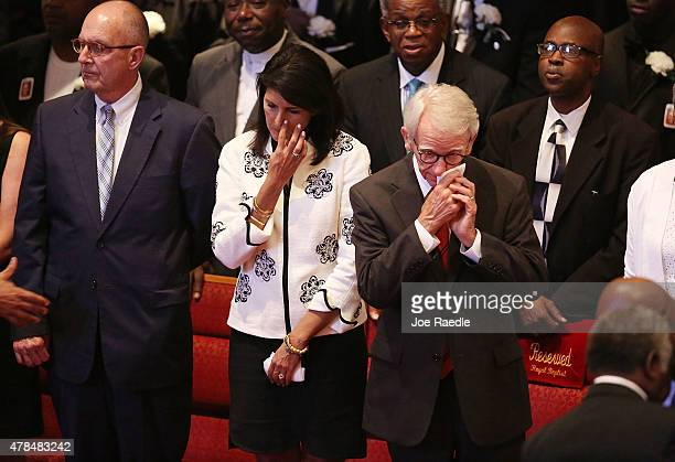 South Carolina Gov Nikki Haley and Charleston Mayor Joseph Riley attend the funeral of Ethel Lance who was one of nine victims of a mass shooting at...