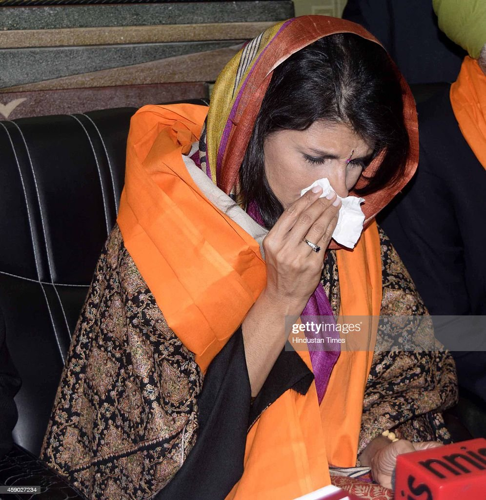 South Carolina Governor Nikki Haley along with her husband Michael Haley wipes tears from her eyes during paying obeisance at Golden Temple on...