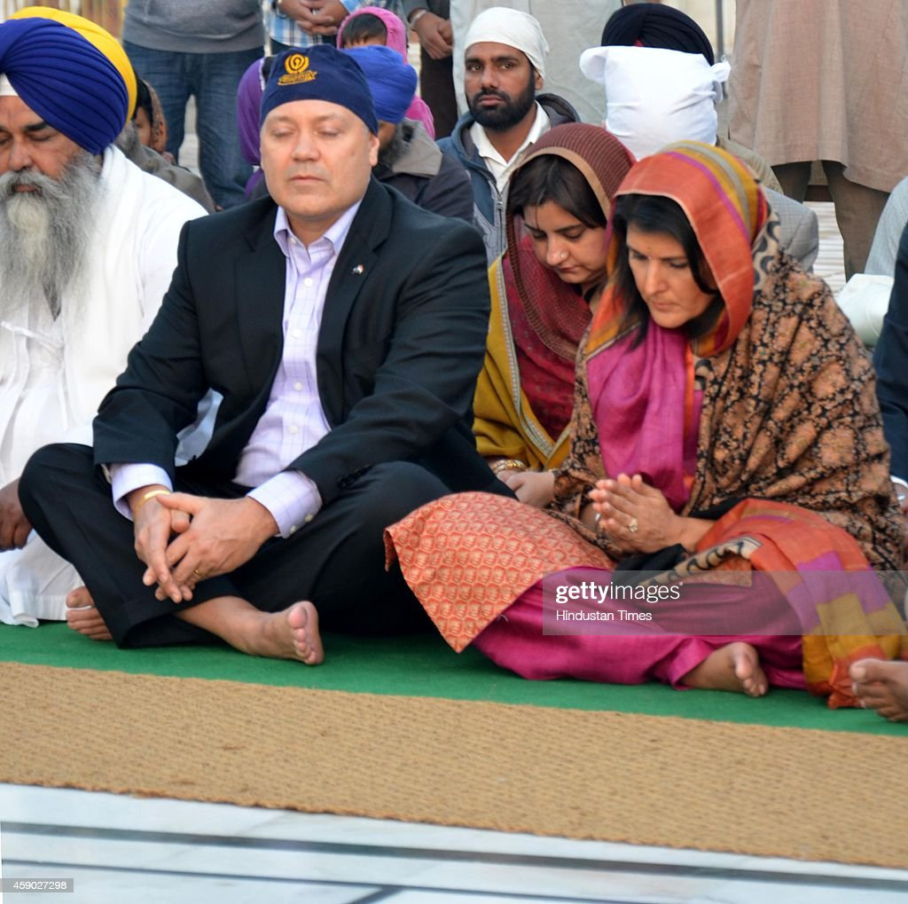 South Carolina Governor Nikki Haley along with her husband Michael Haley paying obeisance at Golden Temple on November 15 2014 in Amritsar India...