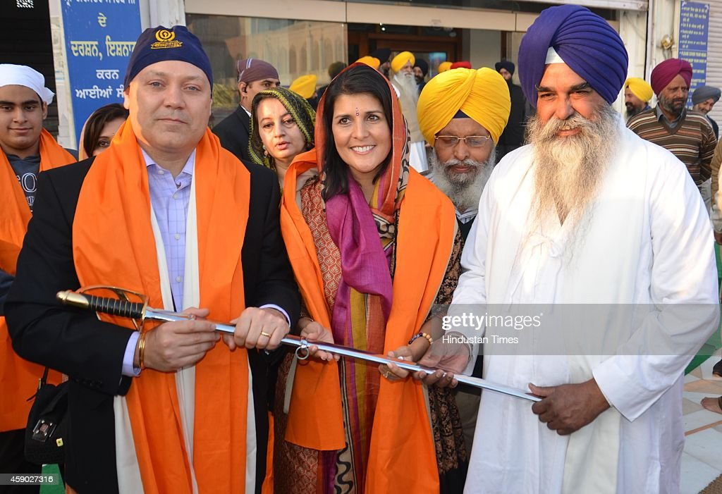 South Carolina Governor Nikki Haley along with her husband Michael Haley being honored by SGPC officials after paying obeisance at Golden Temple on...