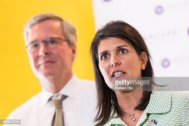 South Carolina Governor Nikki Haley answers a question as Former Florida Governor and potential GOP presidential candidate Jeb Bush looks on during a...
