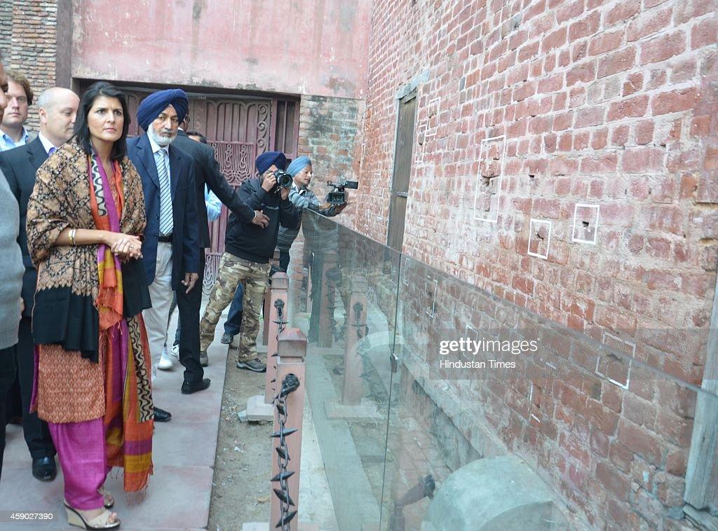South Carolina Governor Nikki Haley looks at the bullet marks on a wall at Jallianwala Bagh on November 15 2014 in Amritsar India Haley said she...