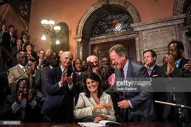 South Carolina Governor Nikki Haley signs a bill to remove the Confederate battle flag from the state house grounds July 9 2015 in Columbia South...