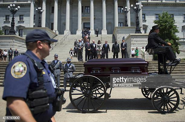 South Carolina Governor Nikki Haley watches as the coffin of church pastor and South Carolina State Sen Clementa Pinckney passes before he lies in...