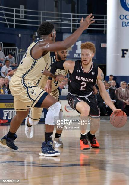 South Carolina guard Hassani Gravett is guarded by FIU guard Brian Beard Jr during a college basketball game between the University of South Carolina...