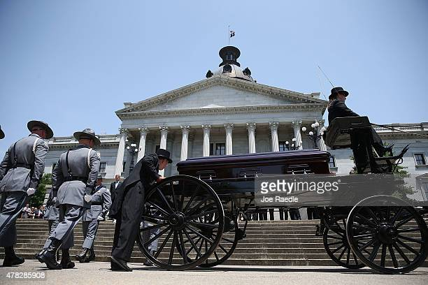 South Carolina Highway Patrol Honor Guard prepare to carry the coffin of church pastor and South Carolina State Sen Clementa Pinckney to lie in...