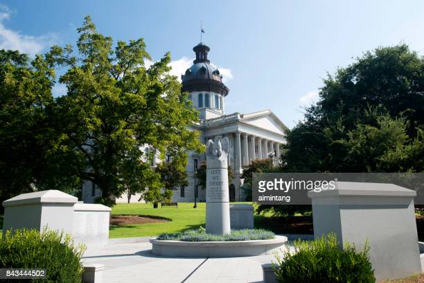 south carolina law enforcement officers memorial with south carolina state house - columbia south carolina stock pictures, royalty-free photos & images
