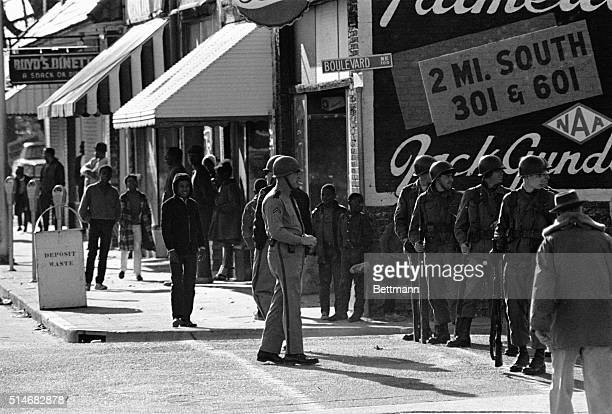 South Carolina National Guardsmen patrol the streets of Orangeburg South Carolina after three African American students were killed during race riots
