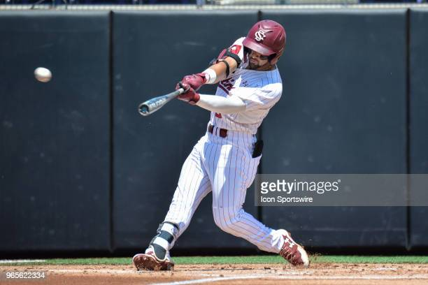 South Carolina outfielder Carlos Cortes makes contact with the ball during the NCAA Baseball Greenville Regional between the South Carolina Gamecocks...