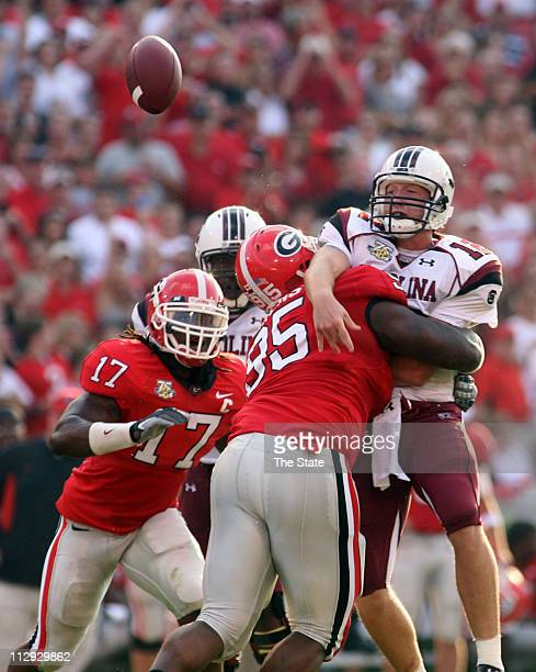 South Carolina quarterback Blake Mitchell barely gets rid of the ball before being tackled by Georgia's Demiko Goodman in the first quarter South...