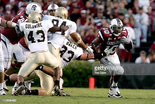South Carolina running back Brian Maddox runs to the left side flat by Wofford defensive end Layton Baker during the first quarter at Williams Brice...