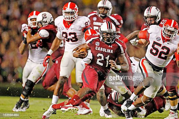 South Carolina running back Marcus Lattimore breaks through the line for a big run and a first down in the third quarter against Georgia at...