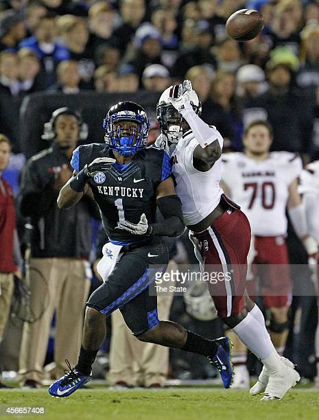 South Carolina safety Brison Williams breaks up a pass intended for Kentucky wide receiver Ryan Timmons in the first half at Commonwealth Stadium in...