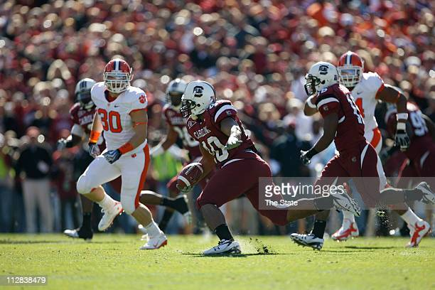 South Carolina senior linebacker Eric Norwood stumbles after picking up a fumble during the first quarter of play against Clemson at Williams Brice...
