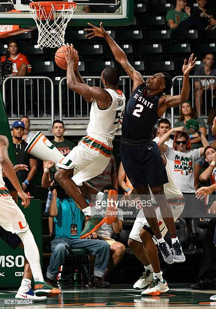 South Carolina State forward Tashombe Riley defends against the shot of Miami guard Davon Reed during an NCAA basketball game between the South...