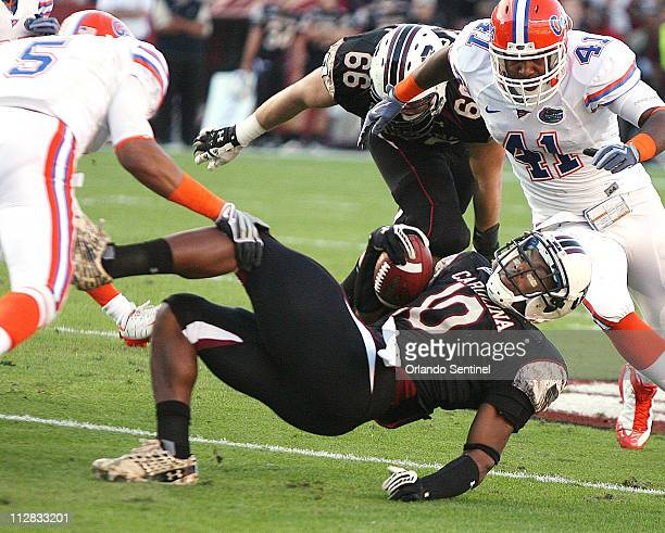 South Carolina tailback Brian Maddox is knocked down by Florida cornerback Joe Haden at WilliamsBrice Stadium in Columbia South Carolina on Saturday...