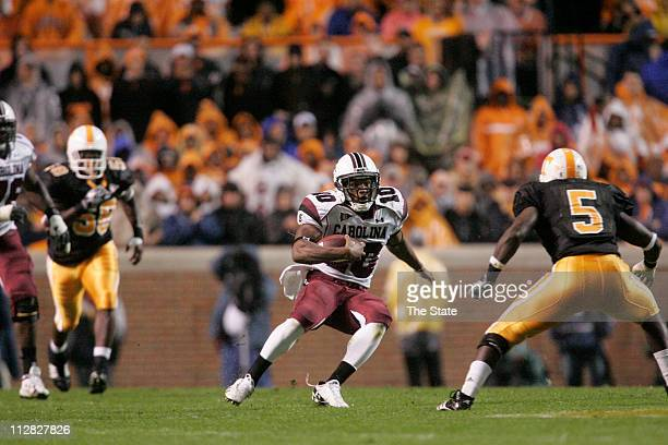 South Carolina tailback Brian Maddox looks to run past Tennessee linebacker Rico McCoy after a firstquarter catch at Neyland Stadium in Knoxville...