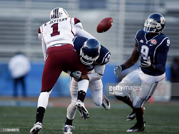 South Carolina wide receiver Alshon Jeffery can't hold onto a pass as Connecticut cornerback Robert McClain defends during the fourth quarter of the...