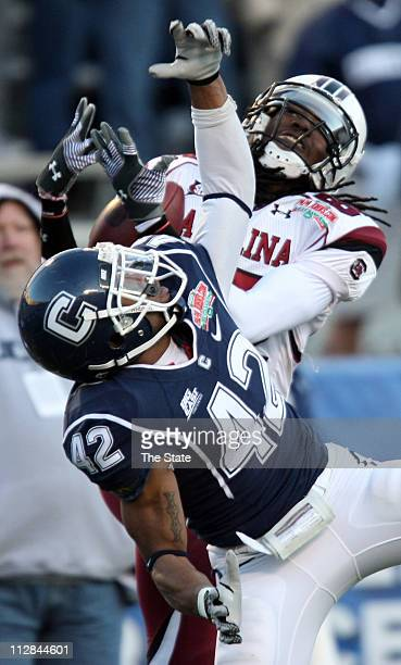 South Carolina wide receiver DL Moore hauls in a pass over Connecticut defender Robert McClain during the second half of the Papa John'scom Bowl...