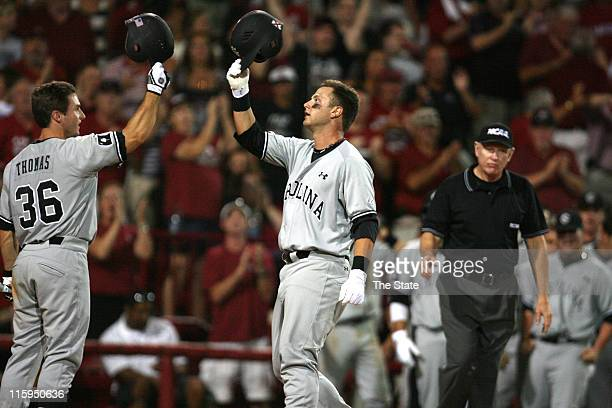 South Carolina's Brady Thomas celebrates with Christian Walker after his home run in the seventh inning during the second game of the Columbia South...