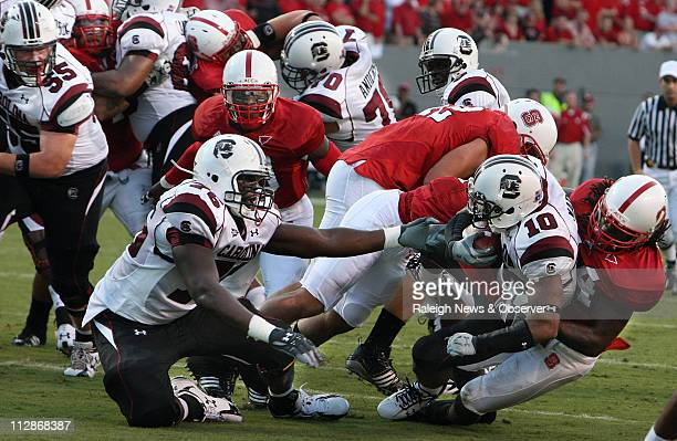 South Carolina's Brian Maddox heads for the goalline after a North Carolina State fumble in the first quarter at CarterFinley Stadium in Raleigh...