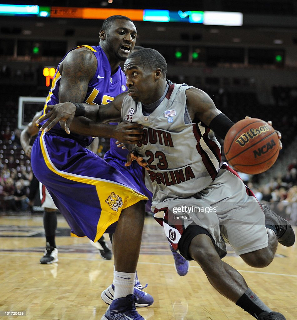 South Carolina's Bruce Ellington (23) drives against Louisiana State's Jalen Courtney in the first half at Colonial Life Arena in Columbia, South Carolina, on Thursday, February 14, 2013. LSU pulled away for a 64-46 win.