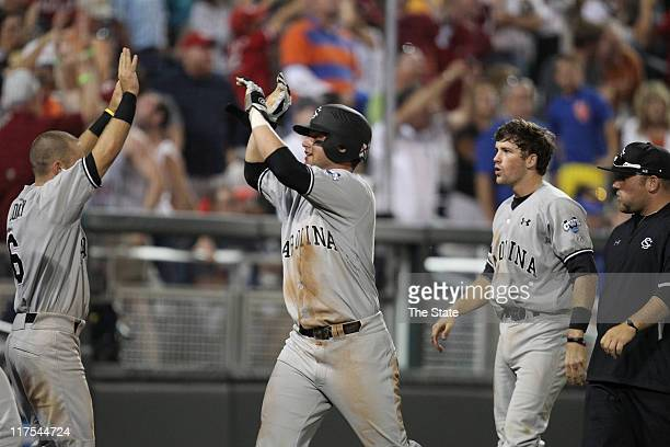 South Carolina's Christian Walker celebrates after scoring on an errant throw by Florida in the 11th inning during Game 1 of the College World Series...