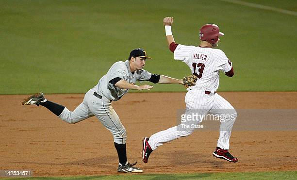 South Carolina's Christian Walker right is tagged out by Tennessee's Will Maddox after a run down between second and first base at Carolina Stadium...