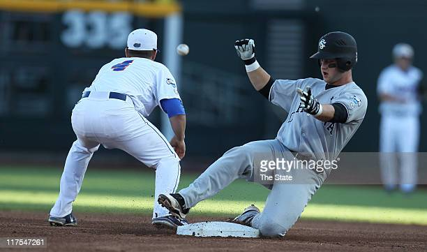 South Carolina's Christian Walker slides into second after connecting on a double in the first inning during Game 1 of the College World Series final...