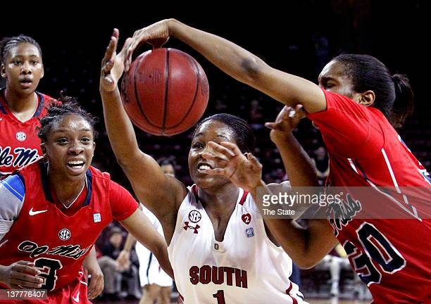 South Carolina's Ebony Wilson and Mississippi's Whitney Hameth battle for the ball as Mississippi's Valencia McFarland looks on during the first half...