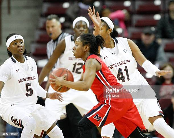 South Carolina's Khadijah Sessions Alaina Coates and Wilka Montout pressure Mississippi's Valencia McFarland during the first half at Colonial Life...
