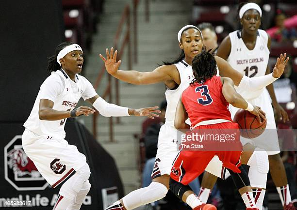 South Carolina's Khadijah Sessions left Alaina Coates and Wilka Montout pressure Mississippi's Valencia McFarland during the first half at Colonial...
