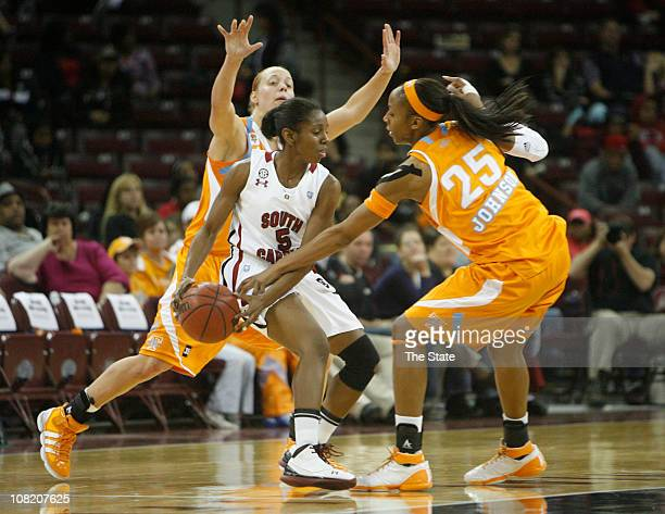 South Carolina's Markeshia Grant feels the pressure from Tennessee's Angie Bjorklund left and Glory Johnson during the second half at the Carolina...