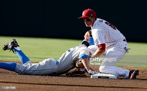 South Carolina's Scott Wingo right tags out UCLA's Brett Krill on a pickoff play in the first inning during Game 2 of the 2010 College World Series...