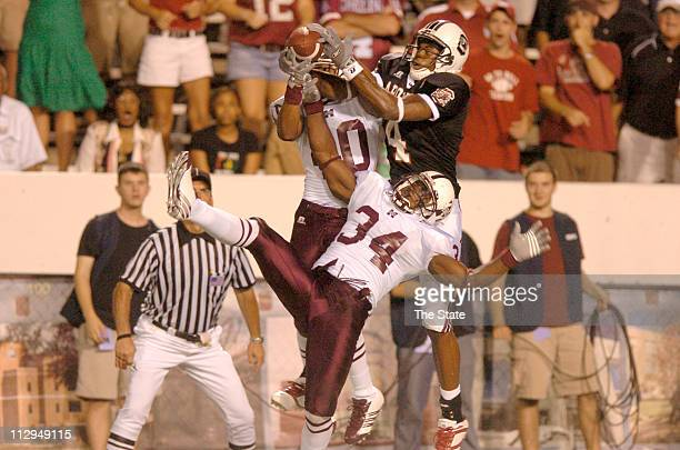 South Carolina's wide receiver Sydney Rice Mississippi State University defensive back Adron Chambers and teammate Jeramie Johnson reach for a Blake...