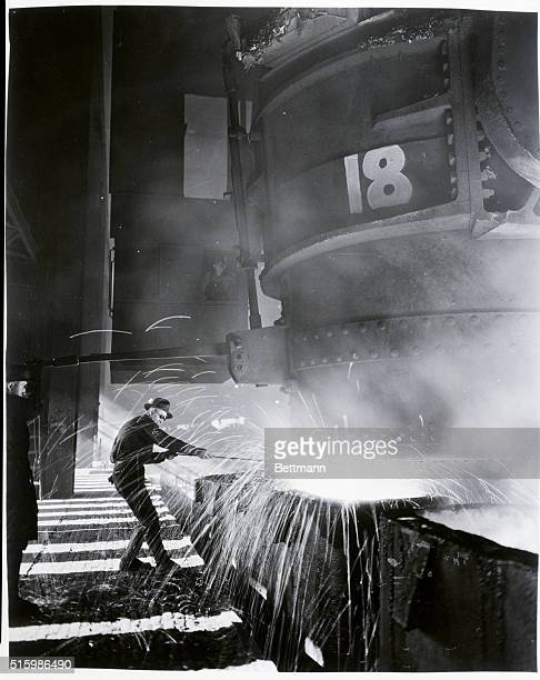 South Chicago Works CarnegieIllinois Steel Corp subsidiary of US Steel Corp A sample test being taken during the pouring of 32000 lb ingots The...