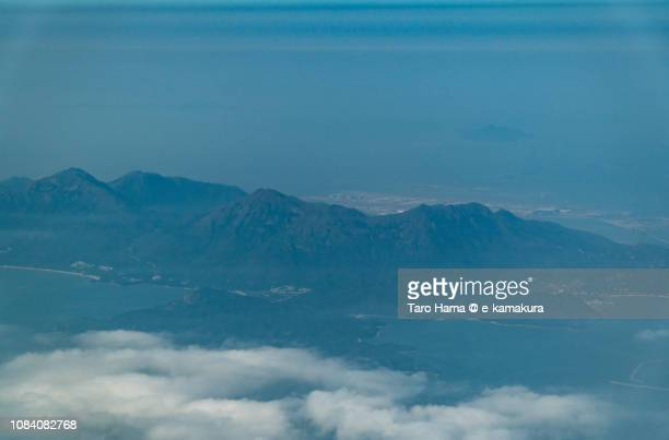 South China Sea and Lantau South Country Park in Lantau Island in Hong Kong daytime aerial view from airplane