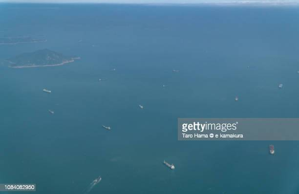 south china sea and zhizhoucun island in china daytime aerial view from airplane - 太平洋 ストックフォトと画像