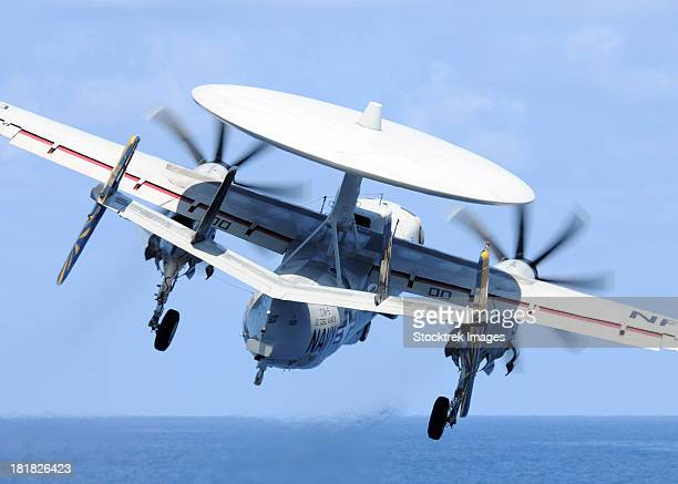 South China Sea, August 13, 2011 - An E-2C Hawkeye launches from the aircraft carrier USS George Washington.